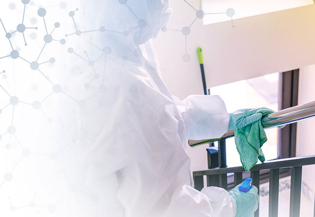 a person wearing personal protective equipment cleaning a facility during the coronavirus pandemic